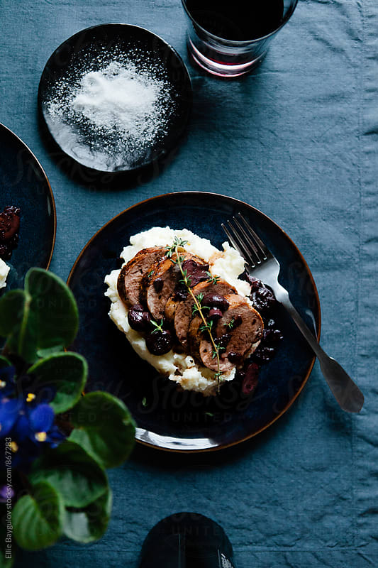 Pork tenderloin with mashed potatoes by Ellie Baygulov for Stocksy United