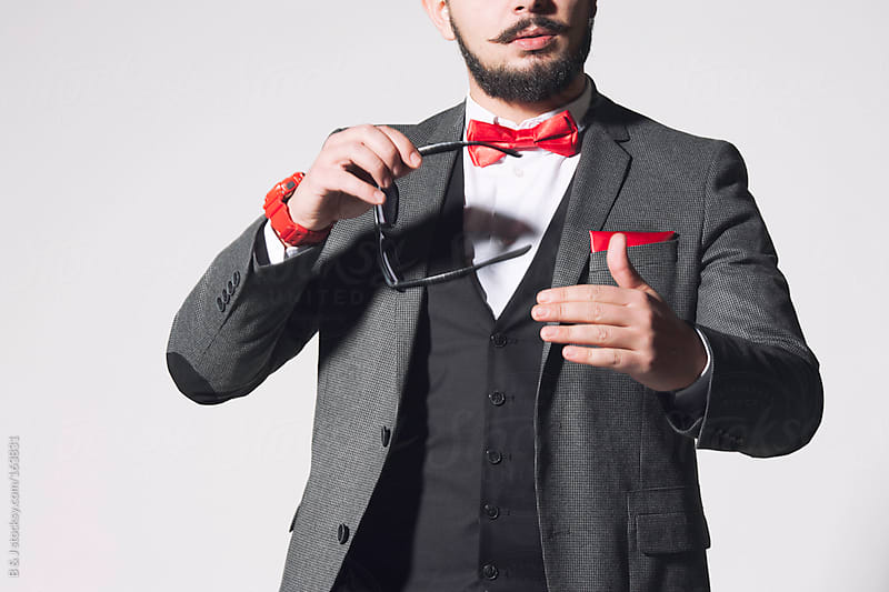 Studio shoot of a guy with a bow tie  by B & J for Stocksy United