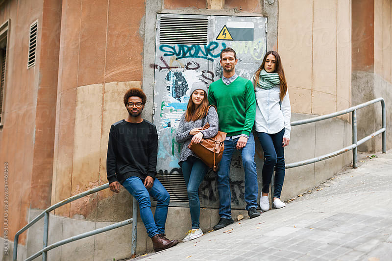Group of young friends standing on the city street. by BONNINSTUDIO for Stocksy United