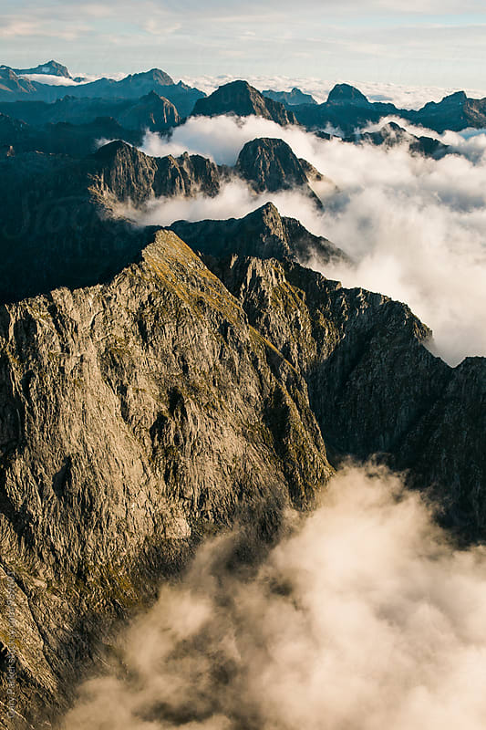 Mountain Peaks and Clouds by Gary Parker for Stocksy United