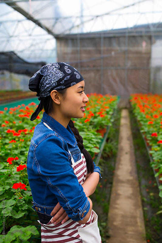 young asian female florist working in the nursery by Bo Bo for Stocksy United