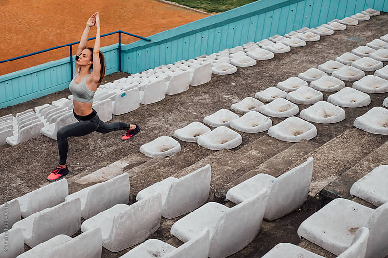 Sporty Woman Stretching by Katarina Radovic for Stocksy United