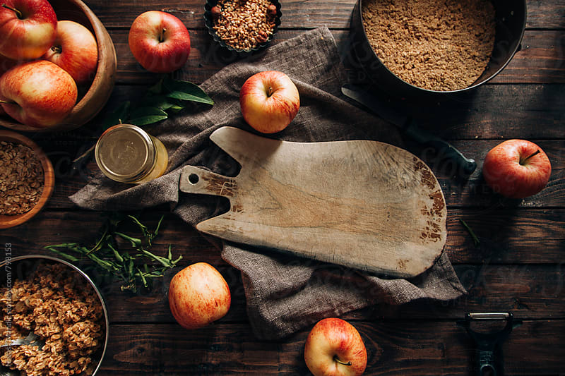 Wooden cut board with ingredients for a crumble apple pie by Nataša Mandić for Stocksy United