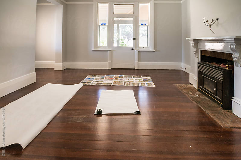 home interior, empty room with templates for couches laid out by Gillian Vann for Stocksy United