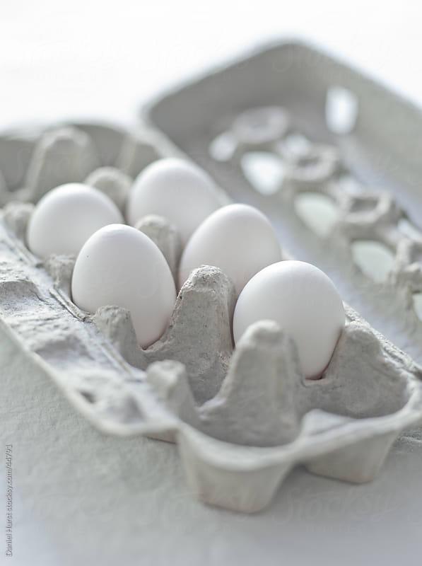 Eggs in carton by Daniel Hurst for Stocksy United