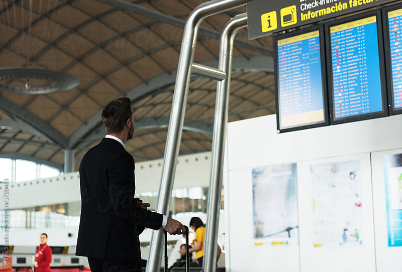 Man in airport checking departure time