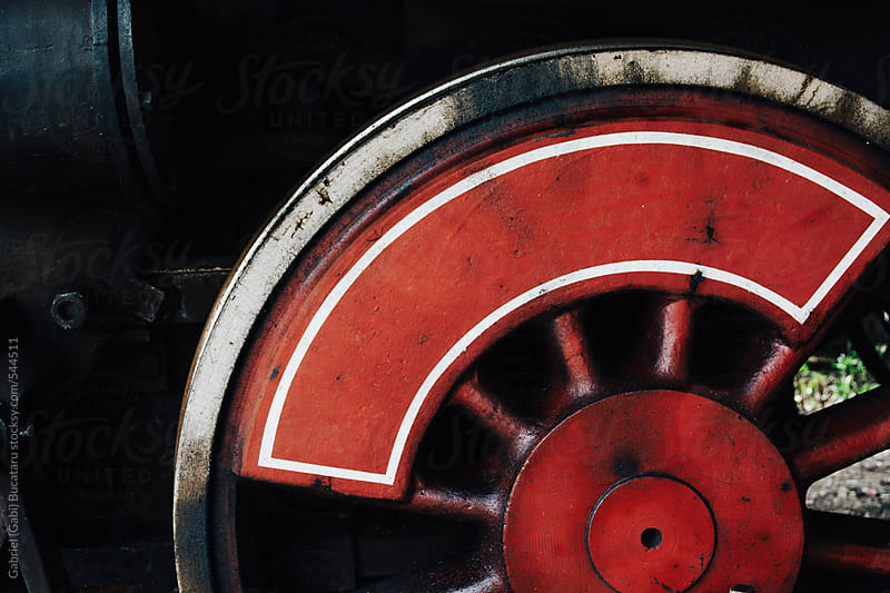 Driving wheel on an old steam engine by Gabriel (Gabi) Bucataru for Stocksy United