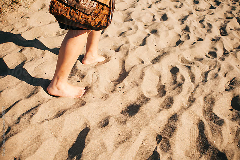 Walking barefoot on the sand by Giada Canu for Stocksy United