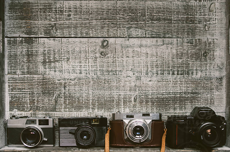 The Old Cameras on a Wooden Board by Brkati Krokodil for Stocksy United