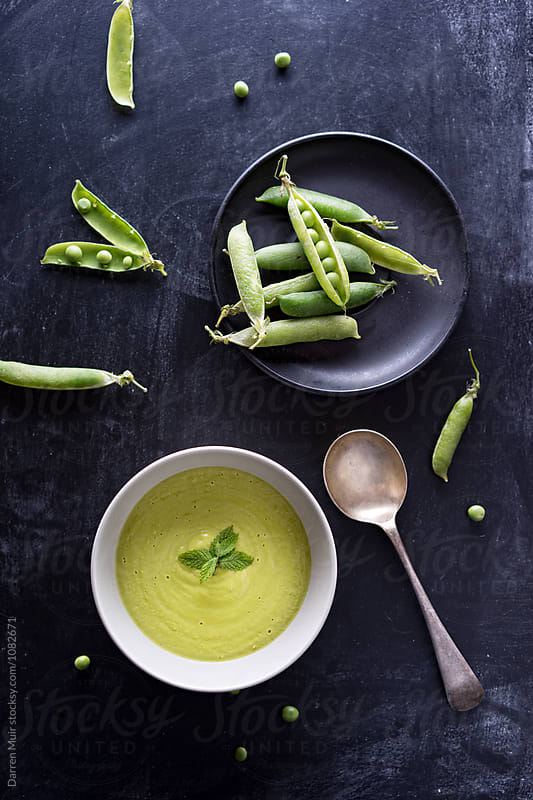 Homemade minted pea soup. by Darren Muir for Stocksy United