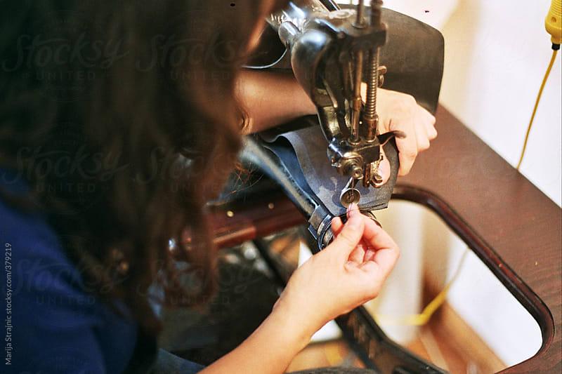Girl sewing by Marija Strajnic for Stocksy United