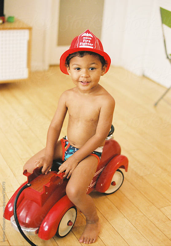 Mixed race little fire fighter by Marlon Richardson for Stocksy United