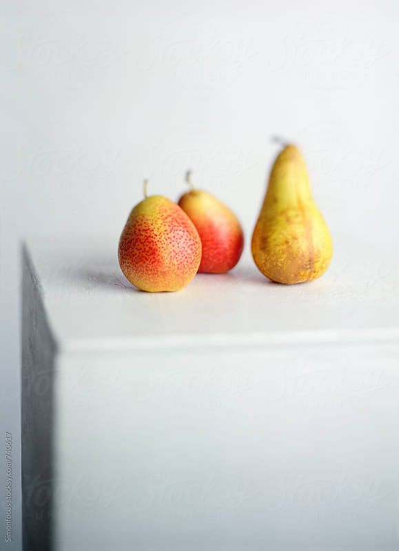 Three organic pears on a pedestal by Simonfocus for Stocksy United