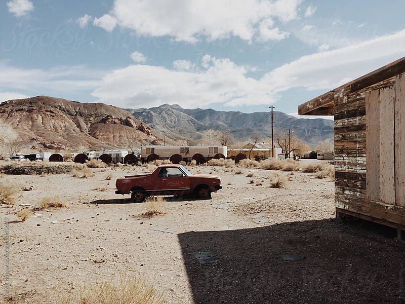 Old Car in Desertscape by Kevin Russ for Stocksy United