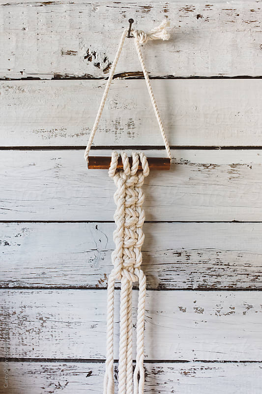 Rope and copper macrame wall hanging by Carey Shaw for Stocksy United