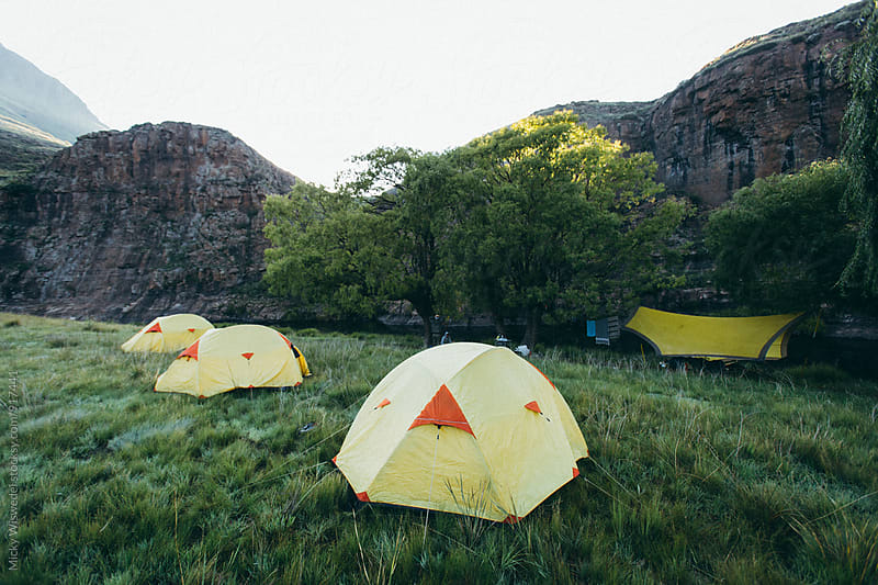tented camp in a scenic wilderness by Micky Wiswedel for Stocksy United