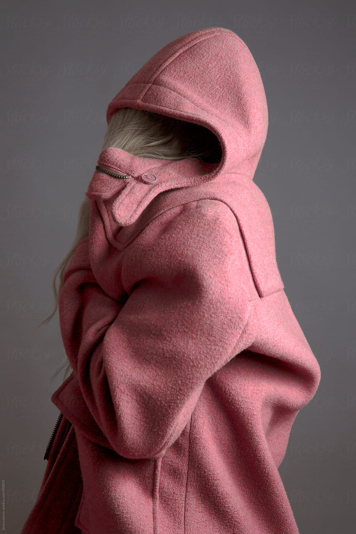 6f838f9274b000 Woman In Pink Coat On Grey Background