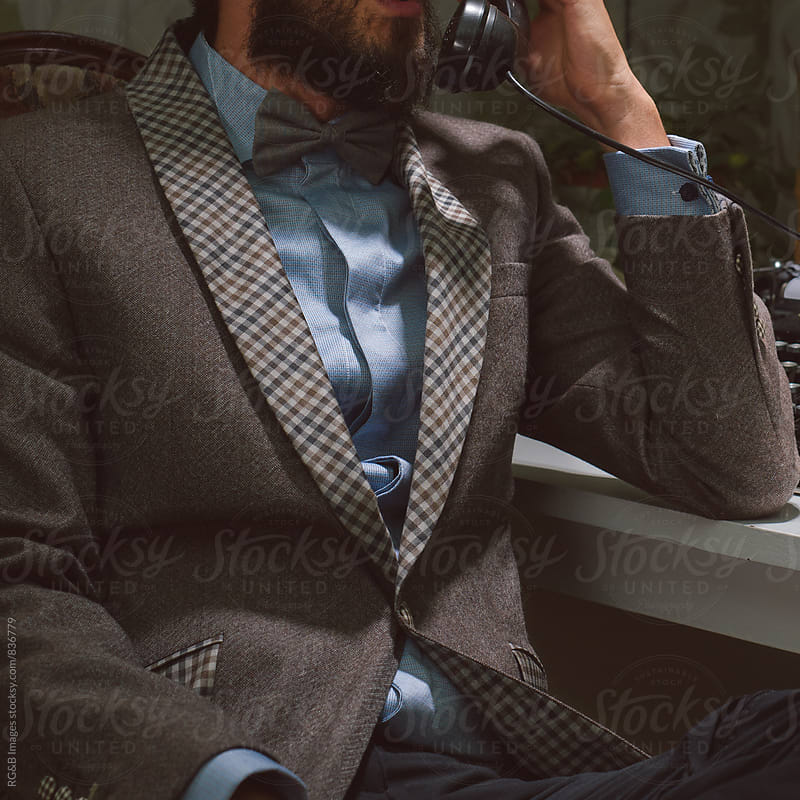 Vintage businessman talking on an antique phone by RG&B Images for Stocksy United
