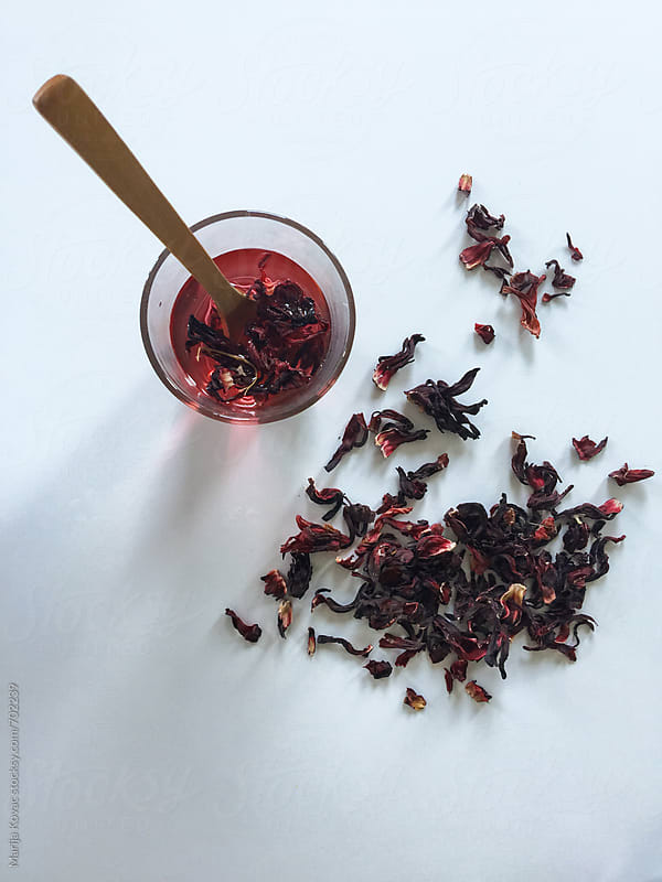 Hibiscus tea in a glass from above  by Marija Kovac for Stocksy United