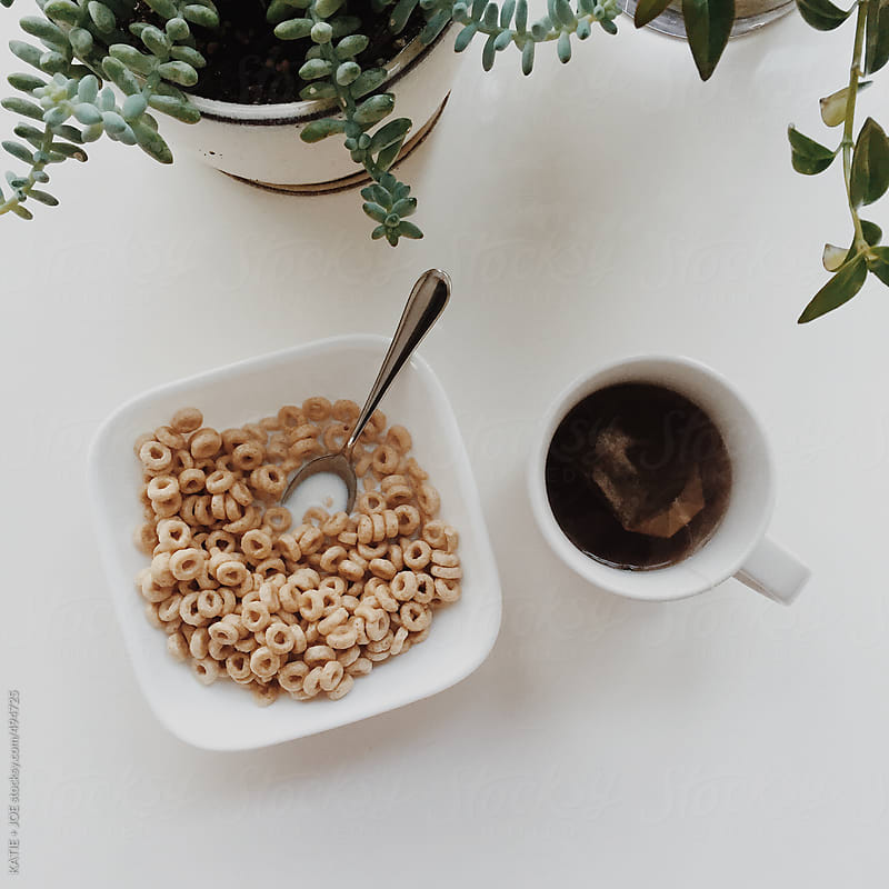 Cereal and tea for breakfast by KATIE + JOE for Stocksy United