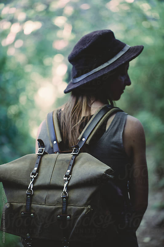 Woman backpacker in the forest by michela ravasio for Stocksy United
