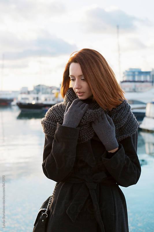 Woman at seaport  by Lyuba Burakova for Stocksy United