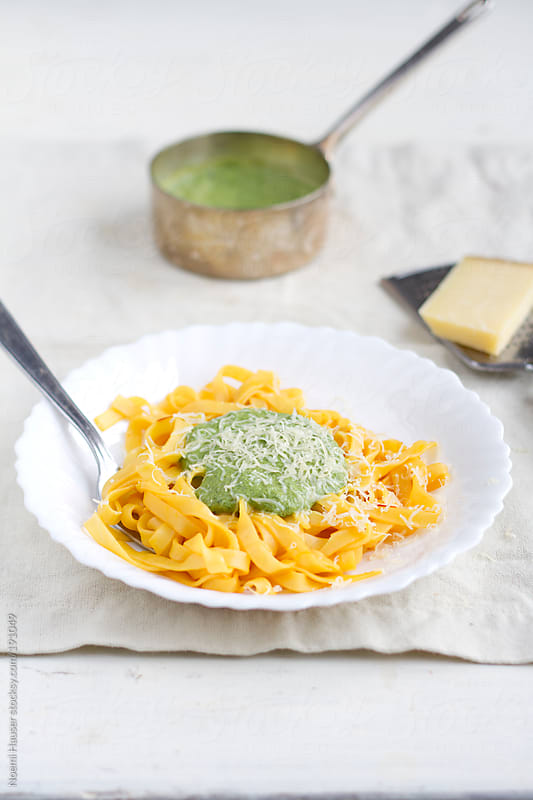 Saffron pasta with spinach sauce by Noemi Hauser for Stocksy United