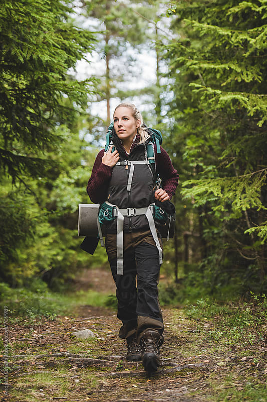 young woman hiking by Andreas Gradin for Stocksy United