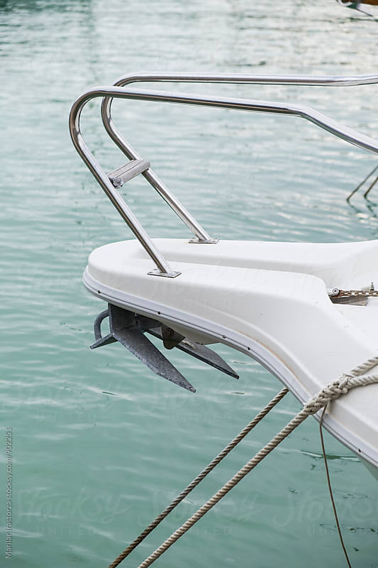 Detail of a yacht in a marina by Marilar Irastorza for Stocksy United