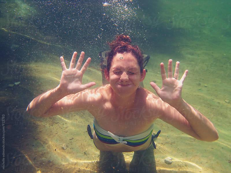 Girl Posing Underwater by michelle edmonds for Stocksy United
