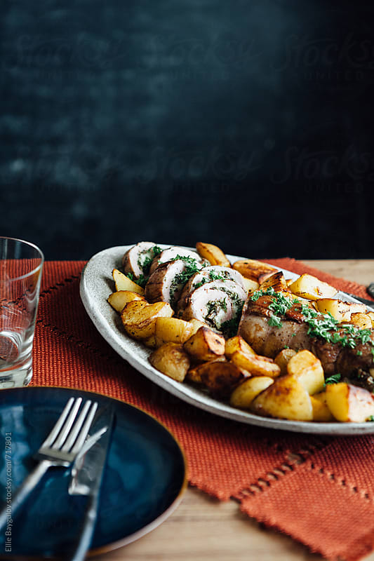 Stuffed  pork tenderloin dish by Ellie Baygulov for Stocksy United