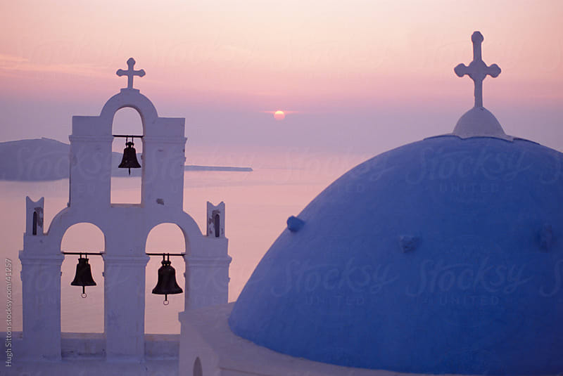 Sunset over Greek Church, Oia, Santorini.  by Hugh Sitton for Stocksy United