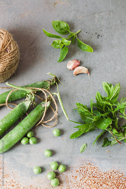 Fresh ingredients - herbs, and vegetables and garlic. by Helen Rushbrook for Stocksy United