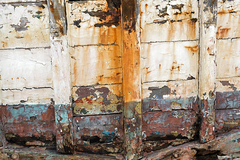 Rear of a wooden boat weathered and in need of repair. by Paul Phillips for Stocksy United