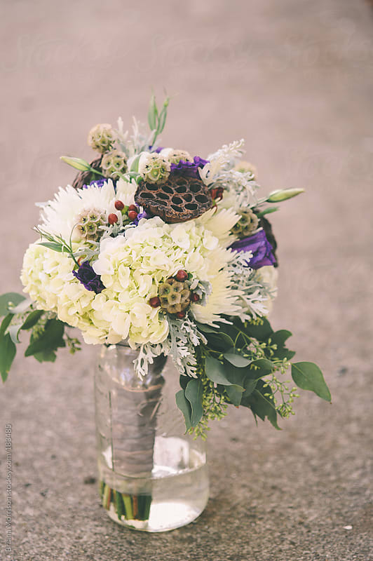 Bridal Bouquet in Glass Jar by Briana Morrison for Stocksy United