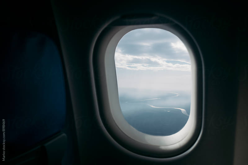 Landscape through airplane window by Marko Milovanović for Stocksy United