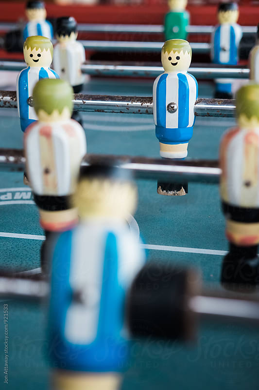 Table football player by Jon Attaway for Stocksy United