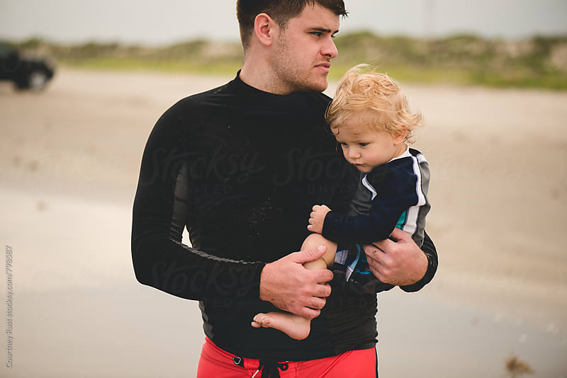 Surfer Daddy and Baby by Courtney Rust for Stocksy United