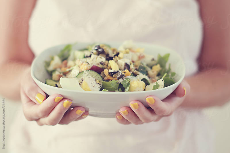 Closeup of female hands holding a salad by Kaat Zoetekouw for Stocksy United