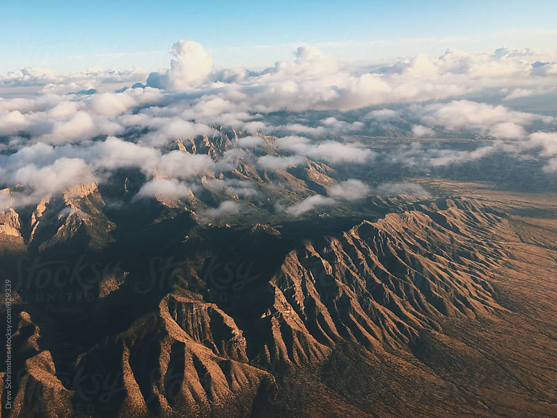 Arial view of mountain range   by Drew Schrimsher for Stocksy United