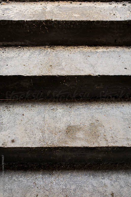 Close up of concrete steps in staircase under construction by Laura Stolfi for Stocksy United