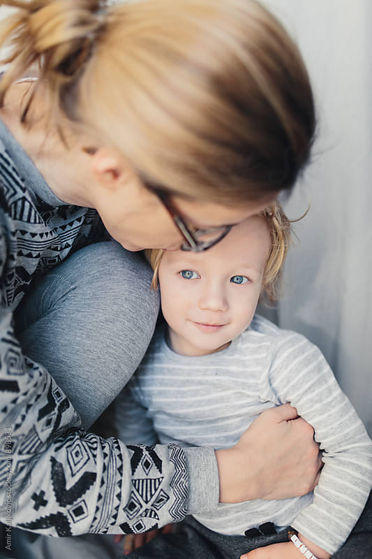 Loving Mom Hugging her Cute Young Son by Amir Kaljikovic for Stocksy United