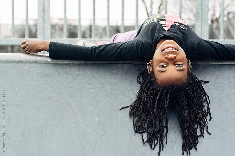 African American girl upside down on a skateboard park ramp by Gabriel (Gabi) Bucataru for Stocksy United