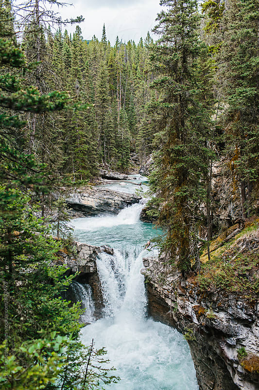 A waterfall in Canada  by Kristen Curette Hines for Stocksy United