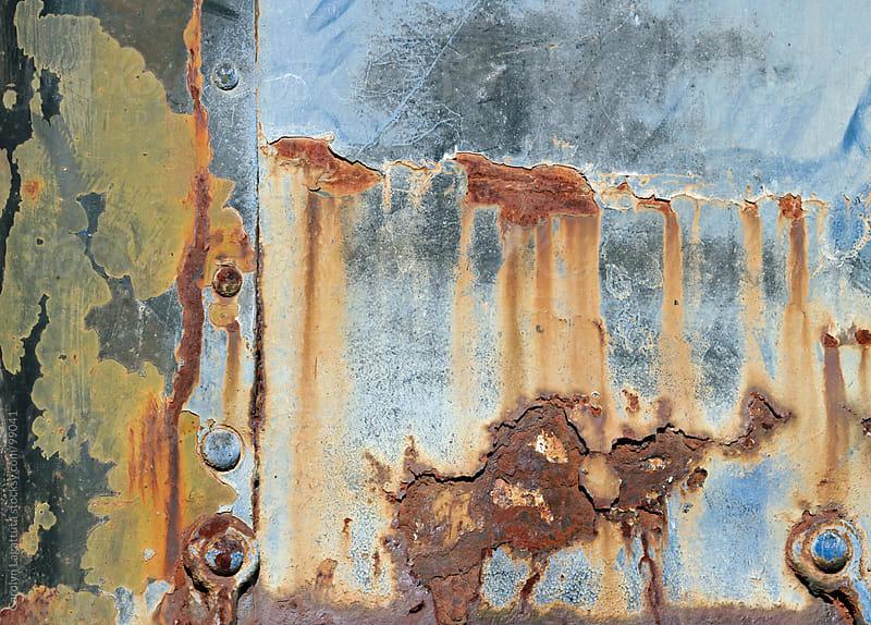 Bleeding, rusty metal by Carolyn Lagattuta for Stocksy United