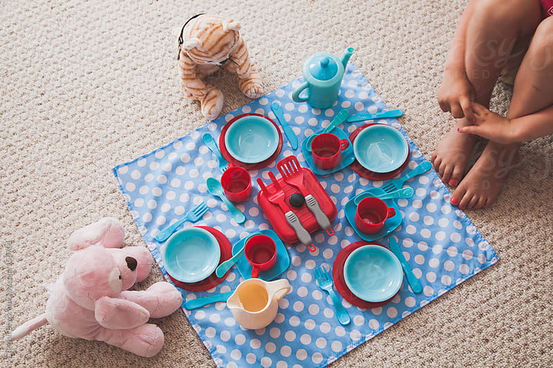 A child's tea set is ready for play. by Cherish Bryck for Stocksy United