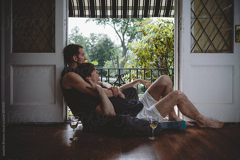 Gay Male Couple Relaxing at Home by Joselito Briones for Stocksy United
