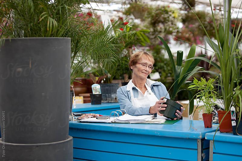 Senior Female Working in Garden Center by Tyler Olson for Stocksy United