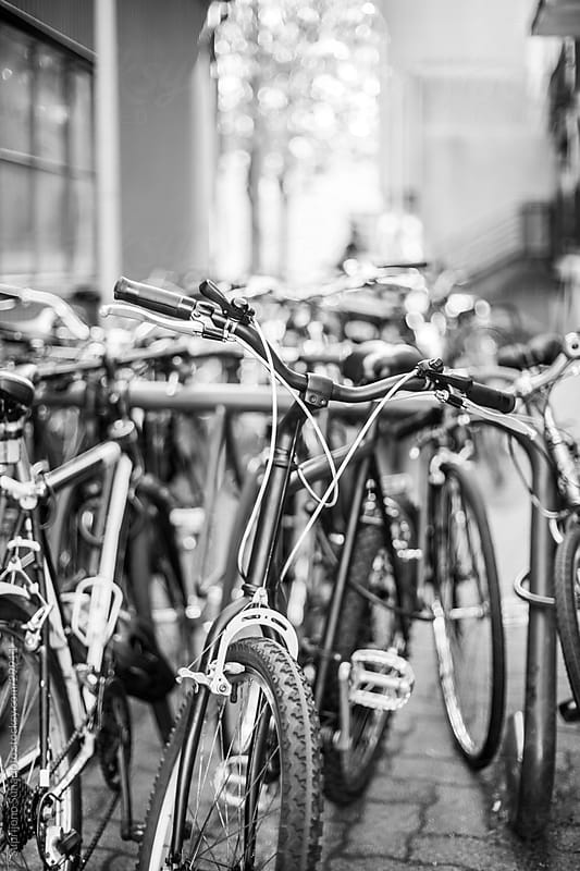 Parked bicycles in black and white by Suprijono Suharjoto for Stocksy United