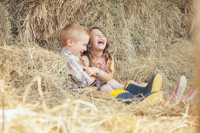 Kids Playing in Straw by Lumina for Stocksy United